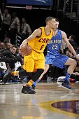 Jared Cunningham of the Cleveland Cavaliers handles the ball against the Orlando Magic on January 2 2016 at Quicken Loans Arena in Cleveland Ohio...