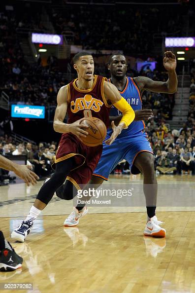 Jared Cunningham of the Cleveland Cavaliers is defended by Dion Waiters of the Oklahoma City Thunder during the second half of their game on December...