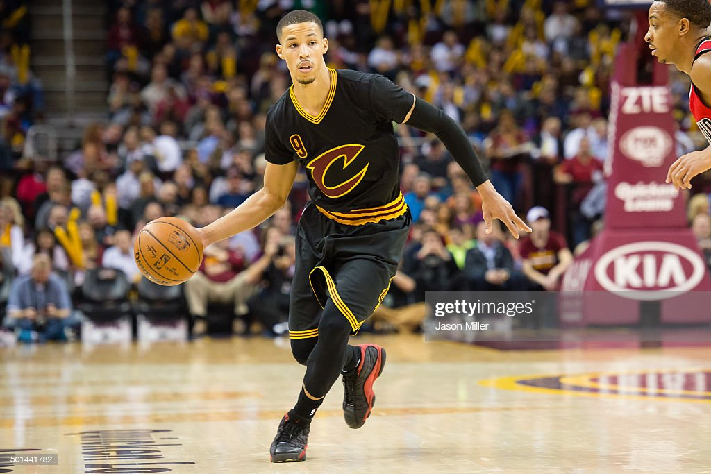 <a gi-track='captionPersonalityLinkClicked' href=/galleries/search?phrase=Jared+Cunningham&family=editorial&specificpeople=6549470 ng-click='$event.stopPropagation()'>Jared Cunningham</a> #9 of the Cleveland Cavaliers looks for a pass while under pressure from <a gi-track='captionPersonalityLinkClicked' href=/galleries/search?phrase=C.J.+McCollum&family=editorial&specificpeople=7688223 ng-click='$event.stopPropagation()'>C.J. McCollum</a> #3 of the Portland Trail Blazers during the second half at Quicken Loans Arena on December 8, 2015 in Cleveland, Ohio. The Cavaliers defeated the Trail Blazers 105-100.
