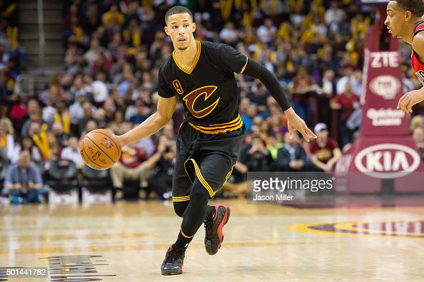Jared Cunningham of the Cleveland Cavaliers looks for a pass while under pressure from CJ McCollum of the Portland Trail Blazers during the second...