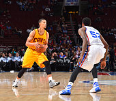 Jared Cunningham of the Cleveland Cavaliers looks to pass the ball against the Philadelphia 76ers during a preseason game at the Wells Fargo Center...