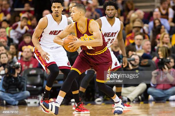 Jared Cunningham of the Cleveland Cavaliers passes during the first half against the Miami Heat at Quicken Loans Arena on October 30 2015 in...