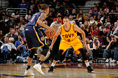 Jared Cunningham of the Cleveland Cavaliers plays defense against the Indiana Pacers on October 15 2015 at Quicken Loans Arena in Cleveland Ohio NOTE...
