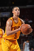 Jared Cunningham of the Cleveland Cavaliers shoots a foul shot against the Philadelphia 76ers during a preseason game at the Wells Fargo Center on...