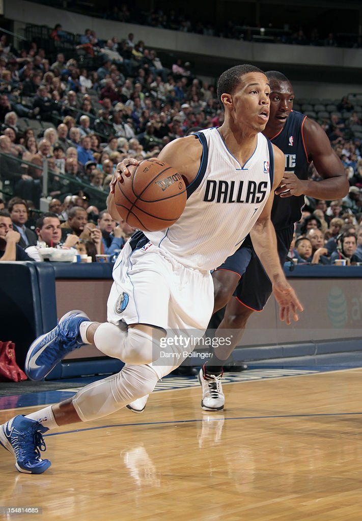 Jared Cunningham #1 of the Dallas Mavericks drives against Bismack Biyombo #0 of the Charlotte Bobcats on October 26, 2012 at the American Airlines Center in Dallas, Texas.