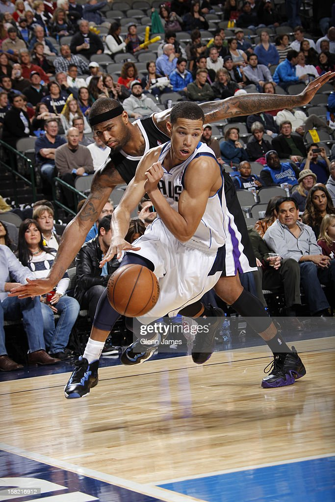Jared Cunningham #1 of the Dallas Mavericks drives to the basket past DeMarcus Cousins #15 of the Sacramento Kings on December 10, 2012 at the American Airlines Center in Dallas, Texas.