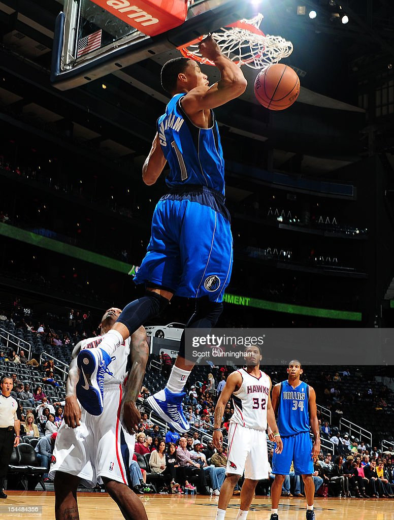 Jared Cunningham #1 of the Dallas Mavericks dunks the ball against the Atlanta Hawks at Philips Arena on October 20, 2012 in Atlanta, Georgia.