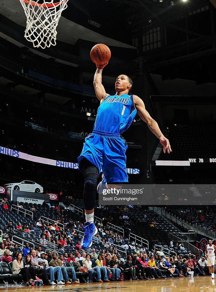 Jared Cunningham #1 of the Dallas Mavericks goes in for the dunk against the Atlanta Hawks at Philips Arena on October 20, 2012 in Atlanta, Georgia.