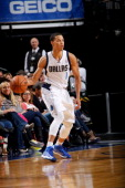 Jared Cunningham of the Dallas Mavericks passes against the Charlotte Bobcats on October 26 2012 at the American Airlines Center in Dallas Texas NOTE...