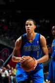 Jared Cunningham of the Dallas Mavericks takes a free throw against the Atlanta Hawks at Philips Arena on October 20 2012 in Atlanta Georgia NOTE TO...