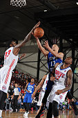 Jared Cunningham of the Delaware 87ers goes to the basket over Willie Reed and LD Williams of the Grand Rapids Drive during the NBA DLeague game on...