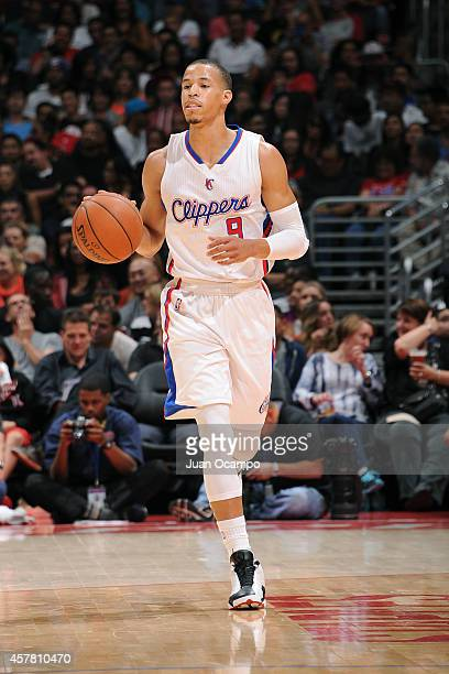Jared Cunningham of the Los Angeles Clippers dribbles down the court during the game against the Portland Trail Blazers on October 24 2014 at the...