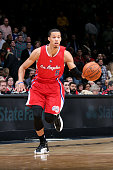 Jared Cunningham of the Los Angeles Clippers drives against the Washington Wizards at the Verizon Center on December 12 2014 in Washington DC NOTE TO...