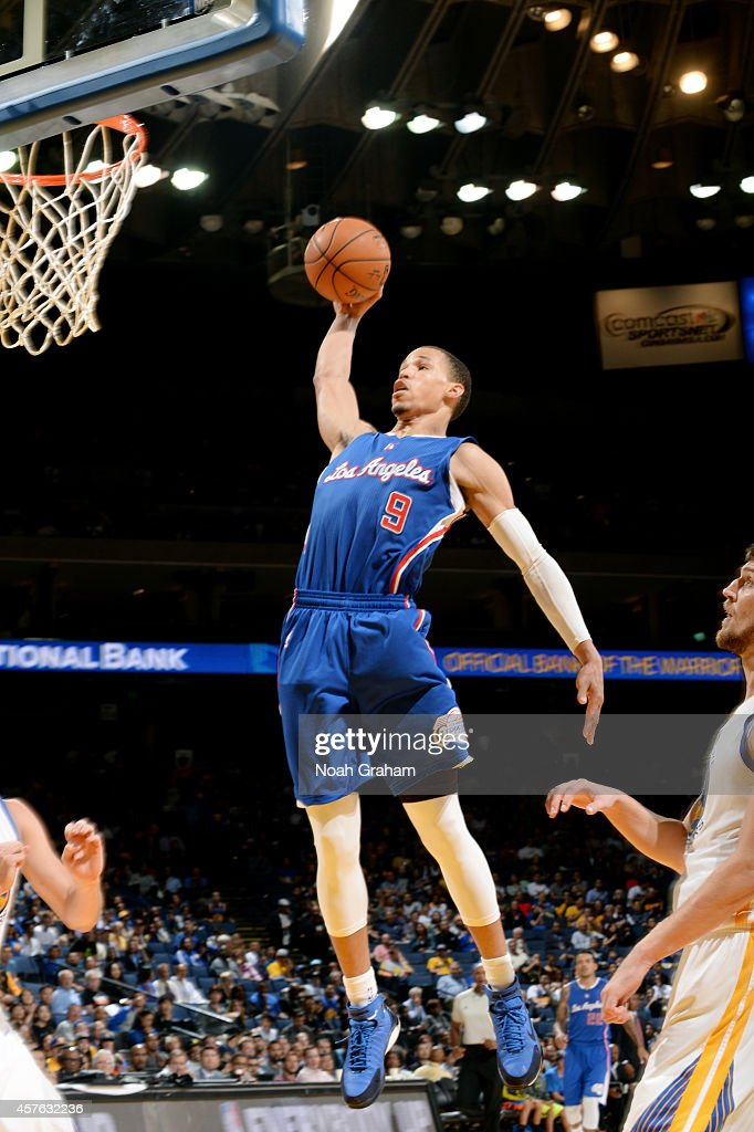 <a gi-track='captionPersonalityLinkClicked' href=/galleries/search?phrase=Jared+Cunningham&family=editorial&specificpeople=6549470 ng-click='$event.stopPropagation()'>Jared Cunningham</a> #9 of the Los Angeles Clippers dunks against the Golden State Warriors on October 21, 2014 at Oracle Arena in Oakland, California.