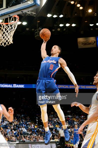 Jared Cunningham of the Los Angeles Clippers dunks against the Golden State Warriors on October 21 2014 at Oracle Arena in Oakland California NOTE TO...