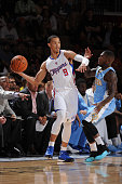 Jared Cunningham of the Los Angeles Clippers handles the basketball during a game against the Denver Nuggets on October 18 2014 at the Mandalay Bay...