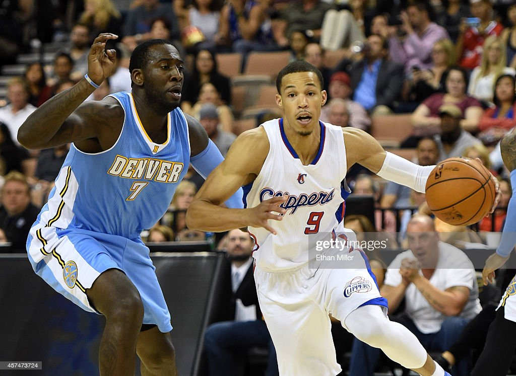 <a gi-track='captionPersonalityLinkClicked' href=/galleries/search?phrase=Jared+Cunningham&family=editorial&specificpeople=6549470 ng-click='$event.stopPropagation()'>Jared Cunningham</a> #9 of the Los Angeles Clippers is fouled as he drives against <a gi-track='captionPersonalityLinkClicked' href=/galleries/search?phrase=J.J.+Hickson&family=editorial&specificpeople=4226173 ng-click='$event.stopPropagation()'>J.J. Hickson</a> #7 of the Denver Nuggets during their preseason game at the Mandalay Bay Events Center on October 18, 2014 in Las Vegas, Nevada. Denver won 104-93.