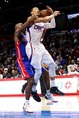 Jared Cunningham of the Los Angeles Clippers is fouled by Jodie Meeks of the Detroit Pistons at Staples Center on December 15 2014 in Los Angeles...