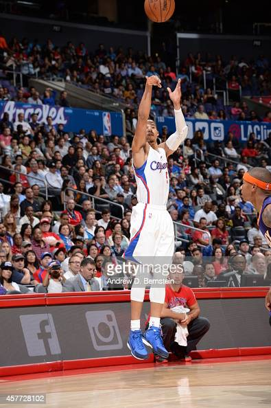 Jared Cunningham of the Los Angeles Clippers takes a shot against the Phoenix Suns during a game on October 22 2014 at the Staples Center in Los...