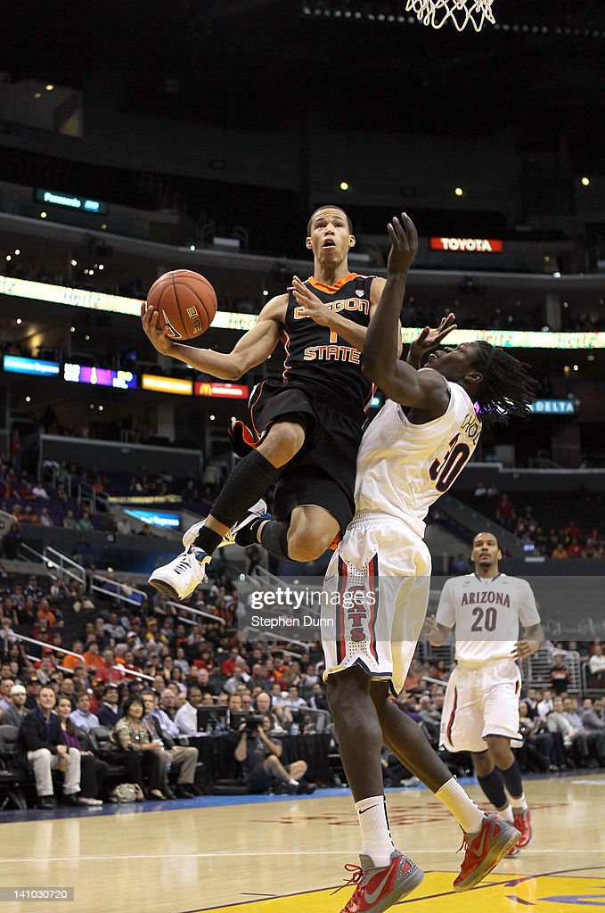 Jared Cunningham #1 of the Oregon State Beavers goes up for a shot against Angelo Chol #30 of the Arizona Wildcats in the first half in the semifinals of the 2012 Pacific Life Pac-12 men's basketball tournament at Staples Center on March 9, 2012 in Los Angeles, California.