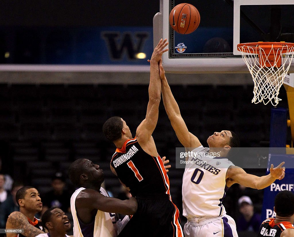 Jared Cunningham #1 of the Oregon State Beavers goes up for a shot over Abdul Gaddy #0 of the Washington Huskies in the second half during the quarterfinals of the 2012 Pacific Life Pac-12 basketball tournament at Staples Center on March 8, 2012 in Los Angeles, California.