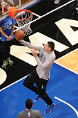 Jared Cunningham of the Orlando Magic warms up before the game against the Dallas Mavericks on February 19 2016 at Amway Center in Orlando Florida Or...
