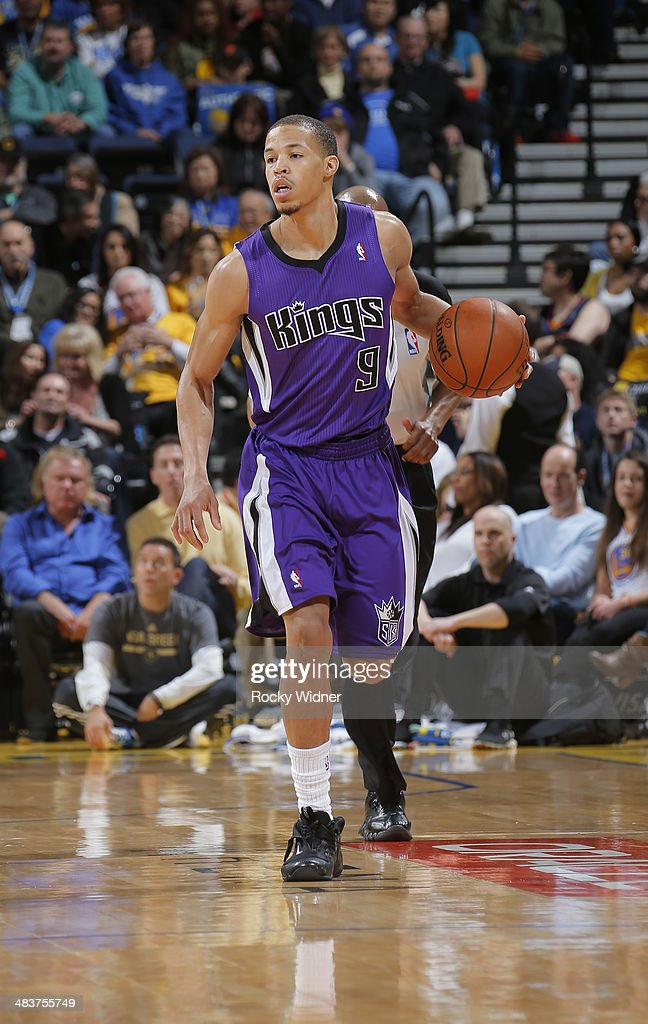 Jared Cunningham #9 of the Sacramento Kings brings the ball up the court against the Golden State Warriors on April 4, 2014 at Oracle Arena in Oakland, California.
