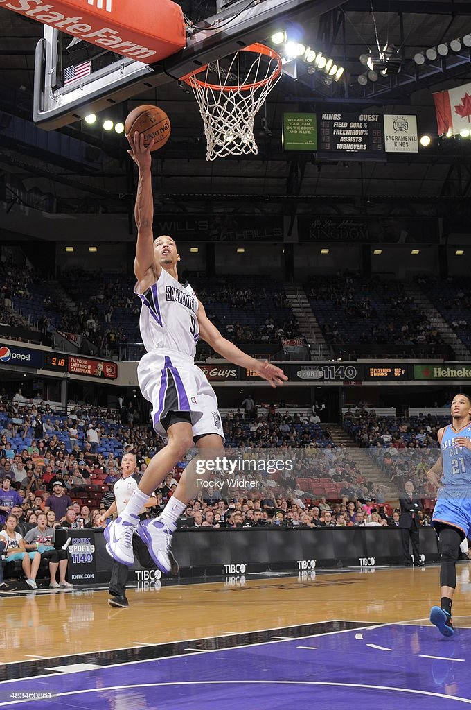 Jared Cunningham #9 of the Sacramento Kings takes the ball to the basket against the Oklahoma City Thunder at Sleep Train Arena on April 8, 2014 in Sacramento, California.