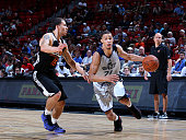 Jared Cunningham of the Utah Jazz drives to the basket against Mike James of the Phoenix Suns on July 14 2015 at the Thomas Mack Center in Las Vegas...