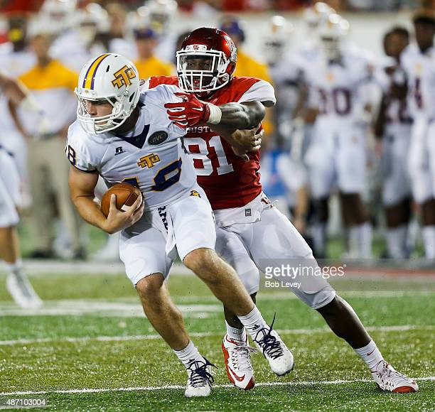Jared Davis of the Tennessee Tech Golden Eagles is sacked by Tyus Bowser of the Houston Cougars on September 5 2015 in Houston Texas