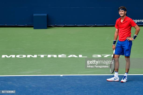 Jared Donaldson of the United States looks on after challenging a call against Lucas Pouille of France during day four of the Rogers Cup presented by...