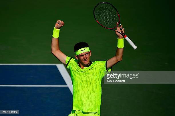 Jared Donaldson of the United States reacts after defeating David Goffin of Belgium during his first round Men's Singles match on Day Two of the 2016...