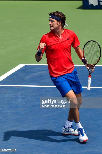 Jared Donaldson of the United States reacts after scoring a point against Diego Schwartzman of Argentina in the men's singles match during day seven...
