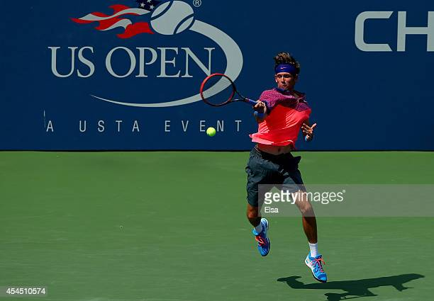 Jared Donaldson of the United States returns a shot against Simone Roncalli of Italy during their junior boys' singles second round match on Day Nine...