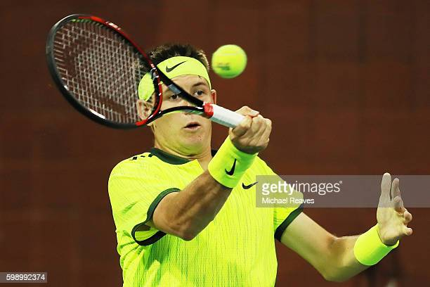Jared Donaldson of the United States returns a shot to Ivo Karlovic of Croatia during his third round Men's Singles match on Day Six of the 2016 US...