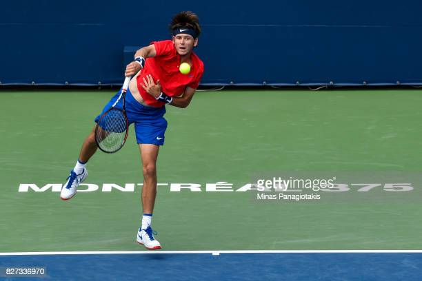 Jared Donaldson of the United States serves against Lucas Pouille of France during day four of the Rogers Cup presented by National Bank at Uniprix...