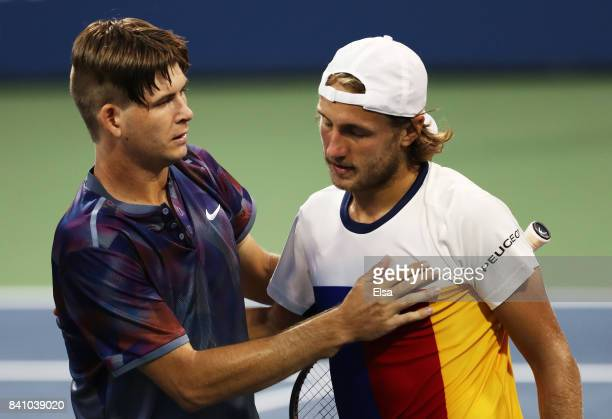 Jared Donaldson of the United States with Lucas Pouille of France after Pouille won their second round Men's Singles match on Day Three of the 2017...