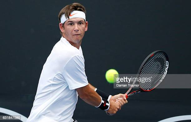 Jared Donaldson of the USA plays a backhand during his first round match against Rogerio Dutra Silva of Brazil on day two of the 2017 Australian Open...