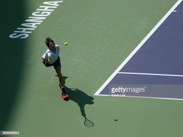 Jared Donaldson of United States returns a shot to Pablo Cuevas of Uruguay during Men's first round match on Day 1 of 2017 ATP 1000 Shanghai Rolex...