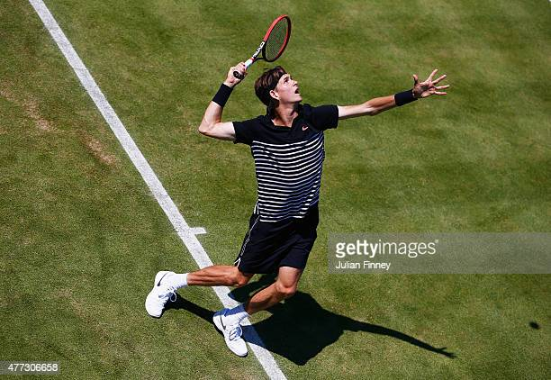Jared Donaldson of USA serves in his men's singles first round match against John Isner of USA during day two of the Aegon Championships at Queen's...