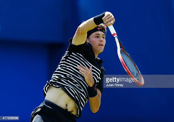 Jared Donaldson of USA smashes in his men's singles first round match against John Isner of USA during day two of the Aegon Championships at Queen's...