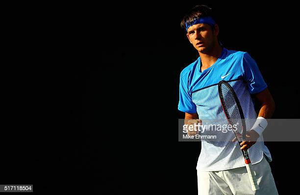 Jared Donaldson plays a match against Yoshihito Nishioka of Japan during Day 3 of the Miami Open presented by Itau at Crandon Park Tennis Center on...