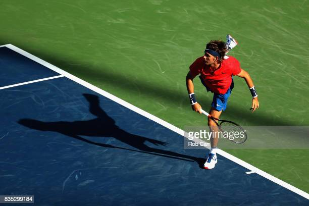 Jared Donaldson plays a shot against John Isner during Day 7 of the Western and Southern Open at the Linder Family Tennis Center on August 18 2017 in...