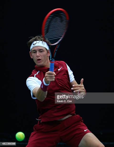 Jared Donaldson returns a forehand to Gilles Muller of Luxembourg during the BBT Atlanta Open at Atlantic Station on July 29 2015 in Atlanta Georgia