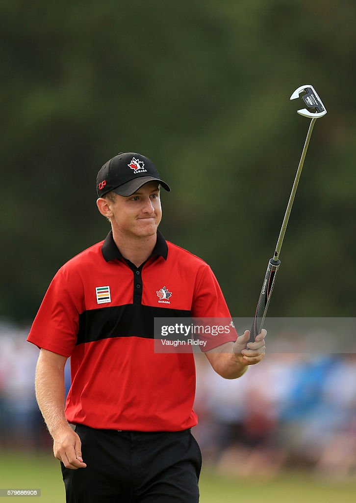 Jared du Toit of Canada acknowledges the crowd on the 18th green during the final round of the RBC Canadian Open at Glen Abbey Golf Club on July 24...