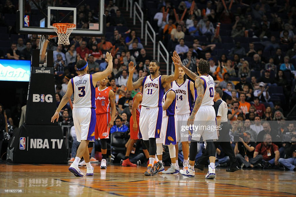 Jared Dudley #3 and Michael Beasley #0 of the Phoenix Suns high five teammate Markieff Morris #11 during the game against the Los Angeles Clippers at US Airways Center on January 24, 2013 in Phoenix, Arizona.