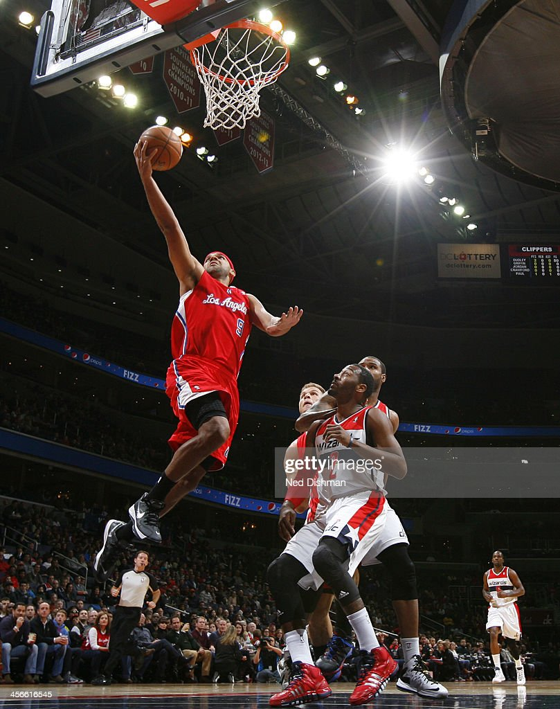 <a gi-track='captionPersonalityLinkClicked' href=/galleries/search?phrase=Jared+Dudley&family=editorial&specificpeople=224071 ng-click='$event.stopPropagation()'>Jared Dudley</a> #9 of the Los Angeles Clippers shoots against John Wall #2 of the Washington Wizards during the game at the Verizon Center on December 14, 2013 in Washington, DC.