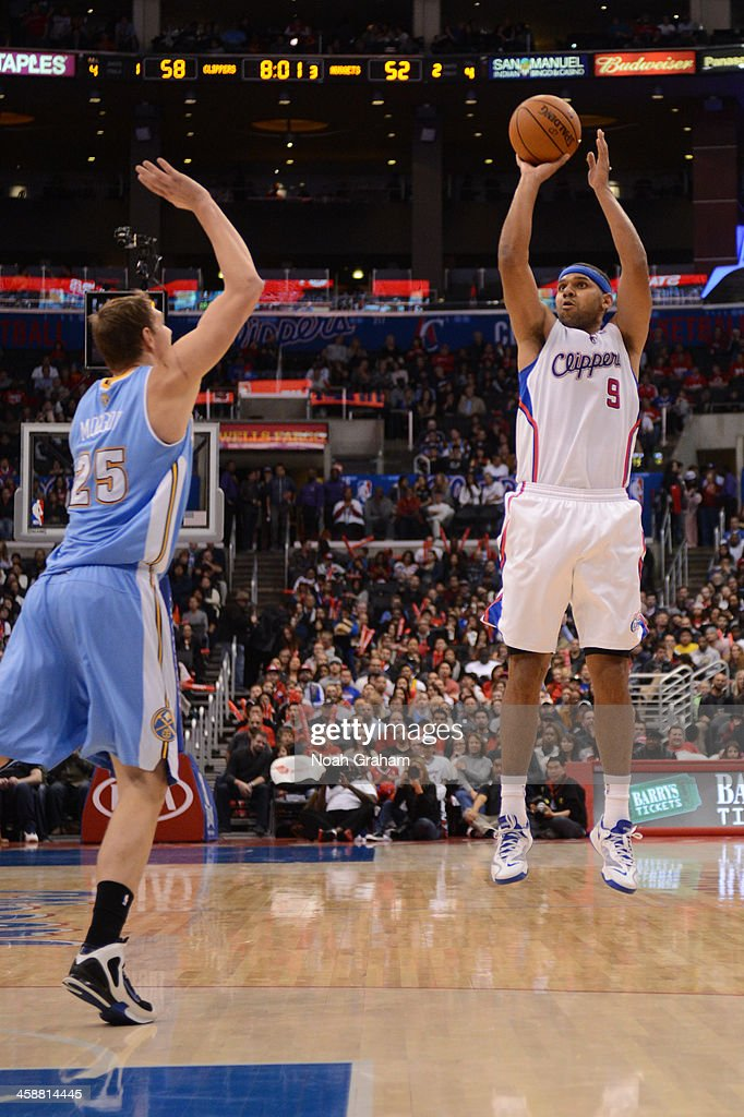 <a gi-track='captionPersonalityLinkClicked' href=/galleries/search?phrase=Jared+Dudley&family=editorial&specificpeople=224071 ng-click='$event.stopPropagation()'>Jared Dudley</a> #9 of the Los Angeles Clippers shoots against the Denver Nuggets at STAPLES Center on December 21, 2013 in Los Angeles, California.