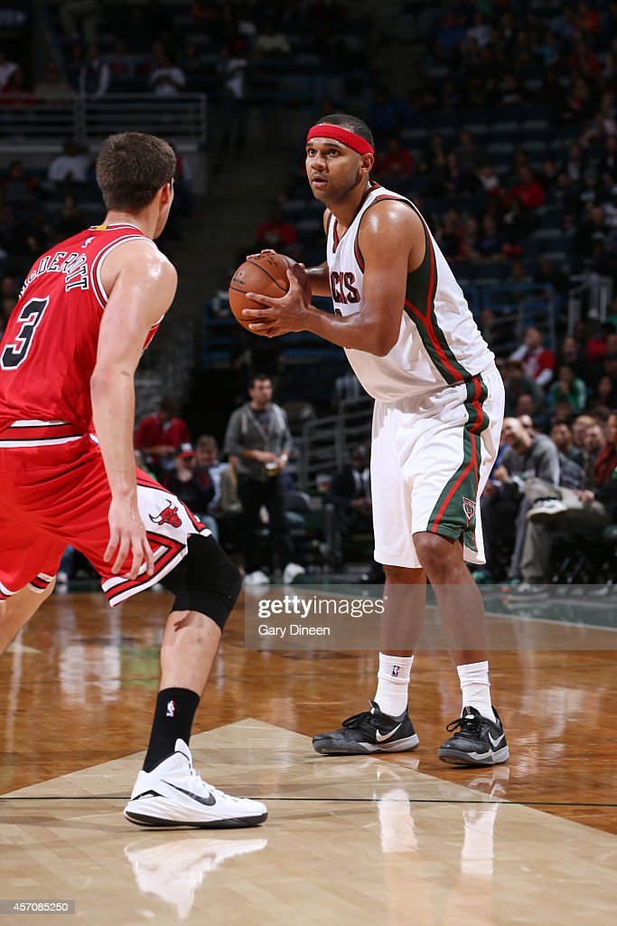 <a gi-track='captionPersonalityLinkClicked' href=/galleries/search?phrase=Jared+Dudley&family=editorial&specificpeople=224071 ng-click='$event.stopPropagation()'>Jared Dudley</a> #9 of the Milwaukee Bucks looks to pass the ball against <a gi-track='captionPersonalityLinkClicked' href=/galleries/search?phrase=Johnny+O%27Bryant+III&family=editorial&specificpeople=7621234 ng-click='$event.stopPropagation()'>Johnny O'Bryant III</a> #3 of the Milwaukee Bucks during the game on October 11, 2014 at BMO Harris Bradley Center, Milwaukee, Wisconsin.