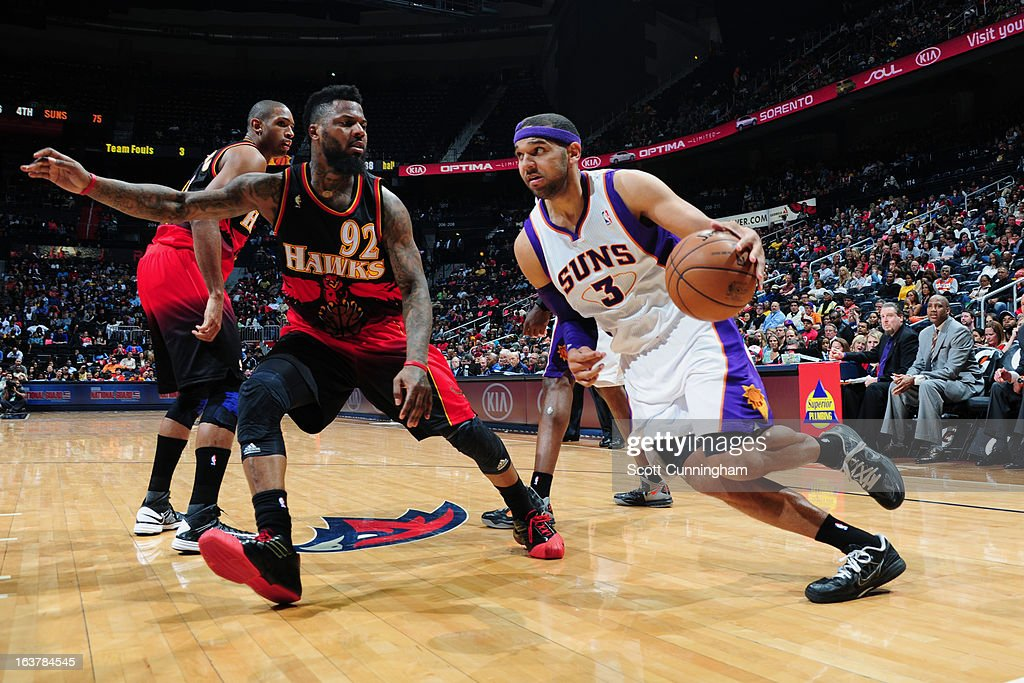Jared Dudley #3 of the Phoenix Suns against DeShawn Stevenson #92 of the Atlanta Hawks on March 15, 2013 at Philips Arena in Atlanta, Georgia.